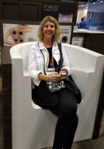 Abbey testing a massage chair at the 2017 Kitchen and Bath Industry Show