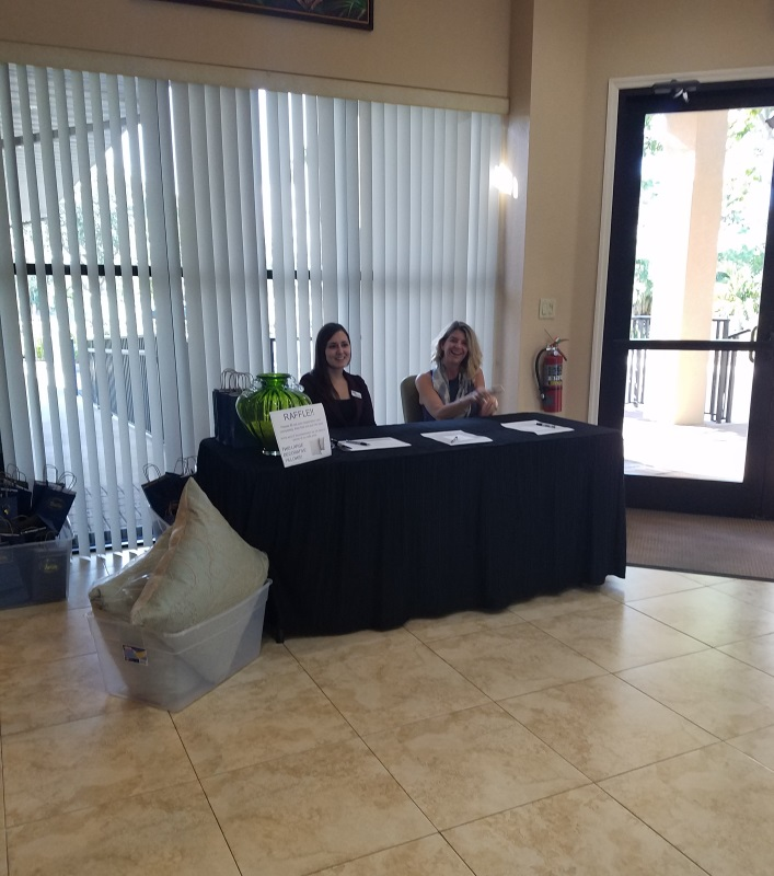 Jessica and Abbey running the Registration booth at the 'Bringing High Point Home' Seminar on October 20th, 2016