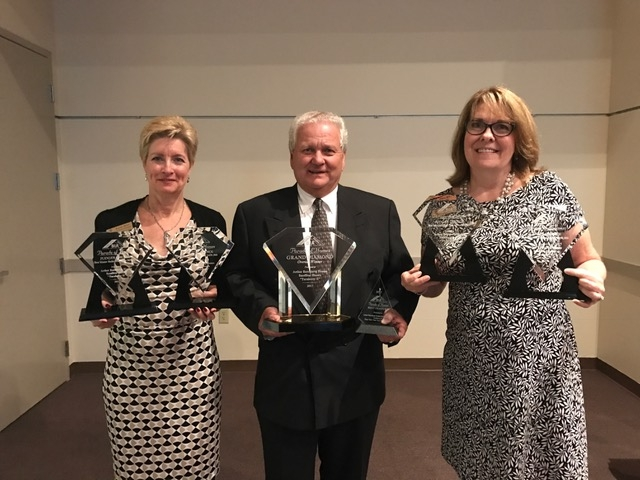 Kathy Mino, Larry Sandles and Teresa McCarthy at the Parade of Homes Banquet on March 2, 2017
