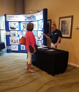 Remodel Sales Associate Tom Bobotas chatting with a seminar attendee