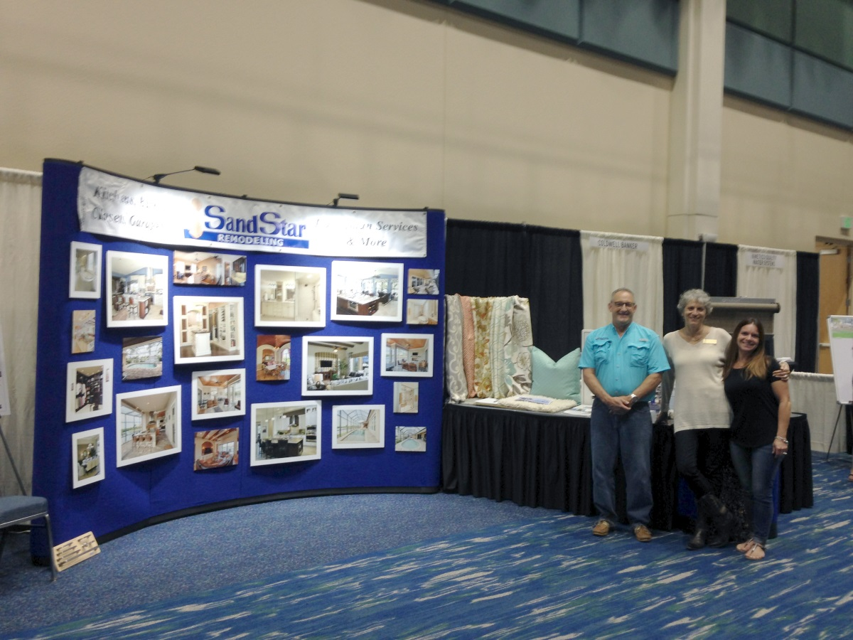 Tom, Olena and Cheryl setting up for the Home Show on January 20th, 2017