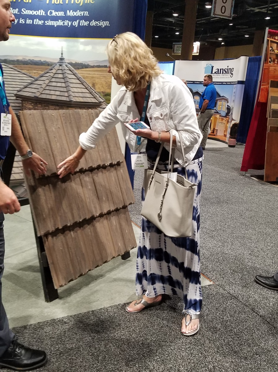 Abbey checking out roof tiles at the SEBC on July 27, 2017