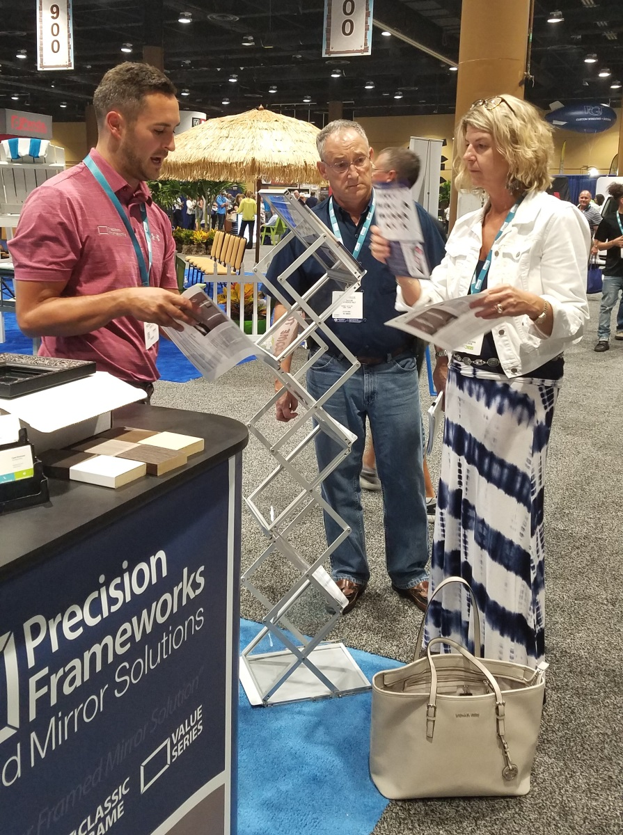 Tom and Abbey visiting a booth at the SEBC on July 27, 2017