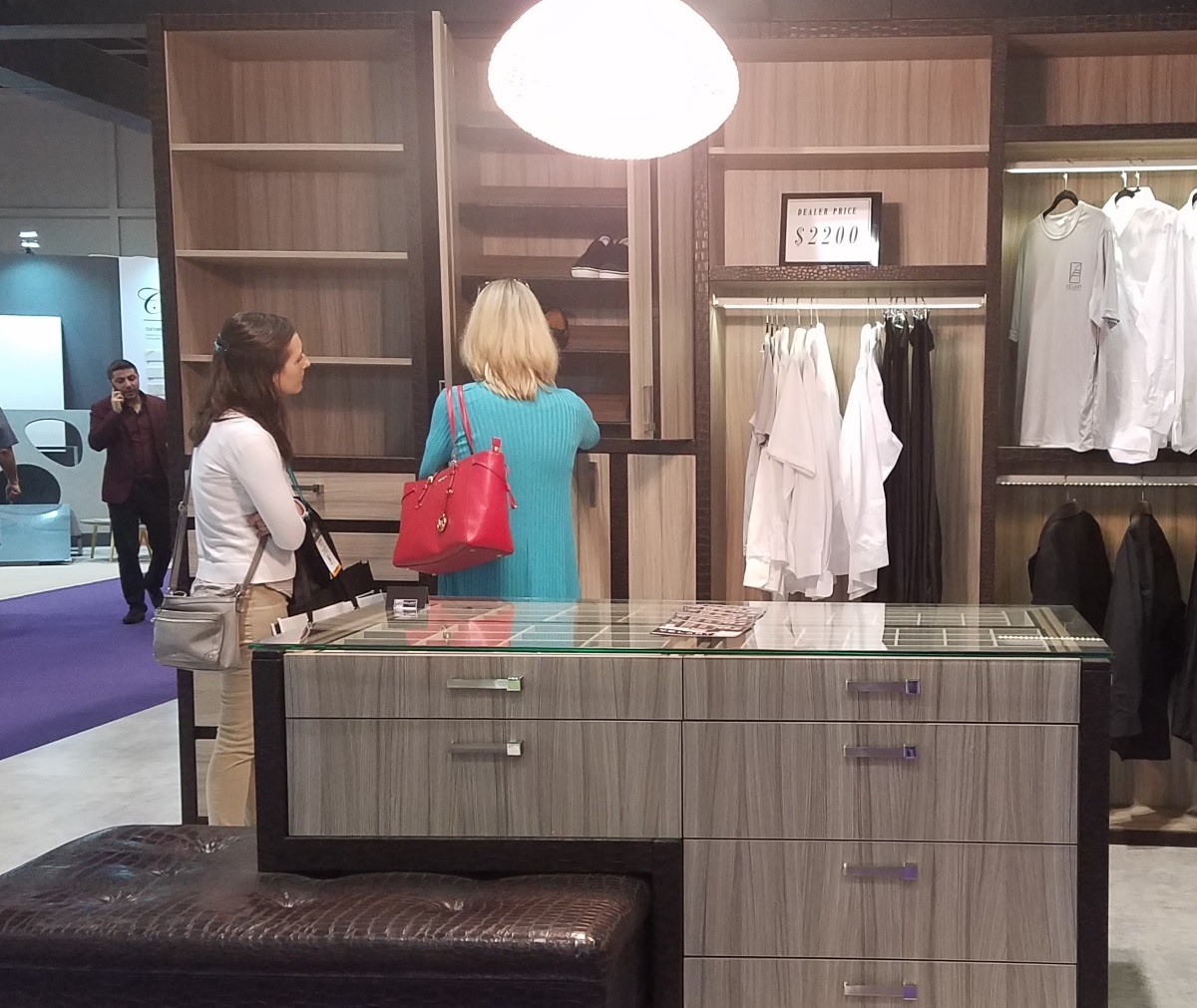Abbey and Jessica exploring a closet system display at the 2018 KBIS