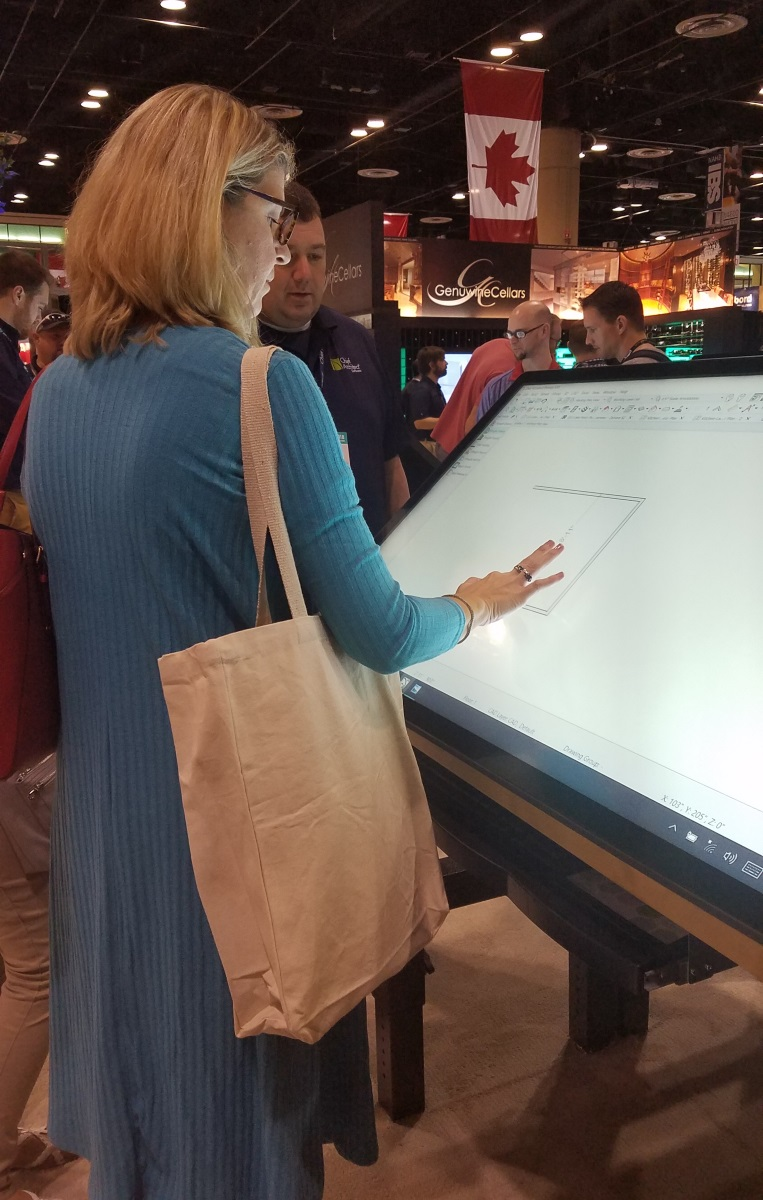 Abbey experimenting with Chief Architect on a touch screen at the 2018 KBIS