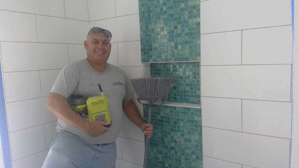 "The SandStar ""Tile Magicians"" hard at work!"