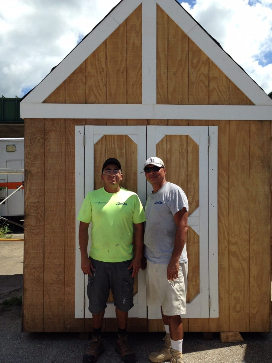 Members of our construction crew helping to finish a shed project for Charlotte Technical College
